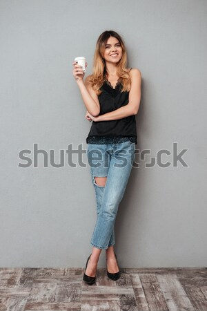 Portrait of smiling woman with red lips speaking on cell phone w Stock photo © deandrobot