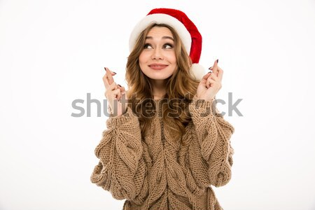 Stock photo: Emotional hopeful young lady dressed in warm sweater