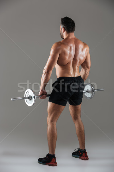 Back view full length of a strong shirtless male bodybuilder Stock photo © deandrobot