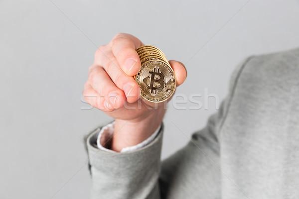 Erkek el altın bitcoin Stok fotoğraf © deandrobot