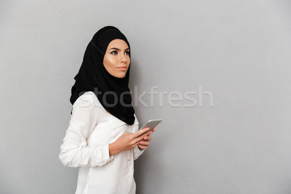 Portrait of gorgeous arab woman in headscarf with oriental makeu Stock photo © deandrobot
