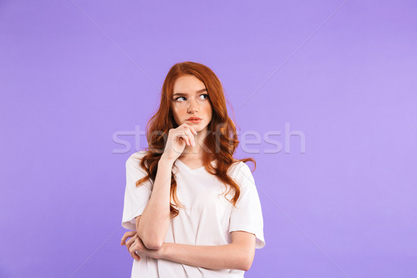Portrait of a pensive young girl standing Stock photo © deandrobot