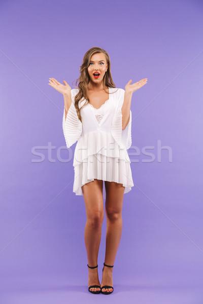 Full length portrait of excited brunette woman 20s wearing dress Stock photo © deandrobot