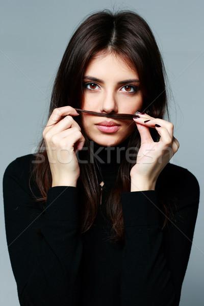 Jeunes belle femme moustache gris visage Photo stock © deandrobot