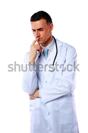 Portrait of a pensive male doctor over white background Stock photo © deandrobot