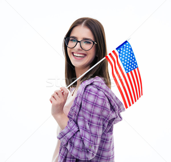 Happy young female student holding US flag Stock photo © deandrobot