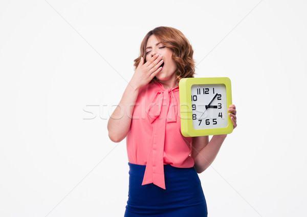 Tired woman holding clock  Stock photo © deandrobot