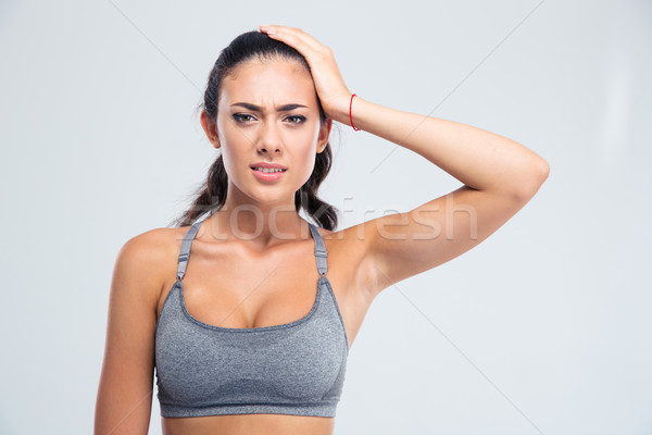 Portrait of a sports woman having headache Stock photo © deandrobot