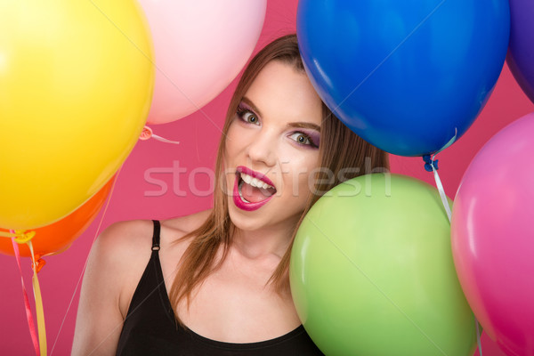 Closeup of excited glamour young female with colorful balloons Stock photo © deandrobot