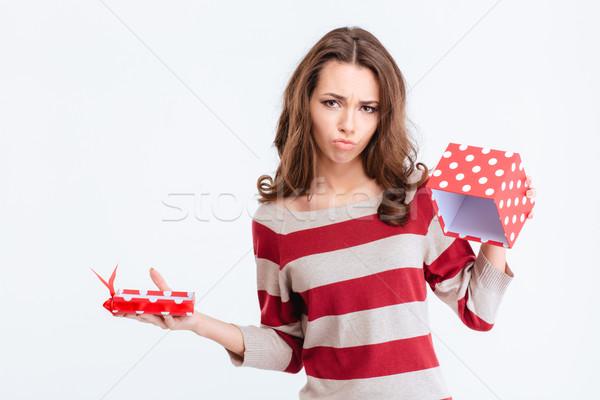 Sad woman holding empty gift box Stock photo © deandrobot