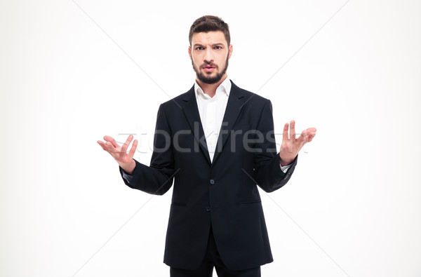 Handsome puzzled businessman with beard holding copyspace in both hands Stock photo © deandrobot