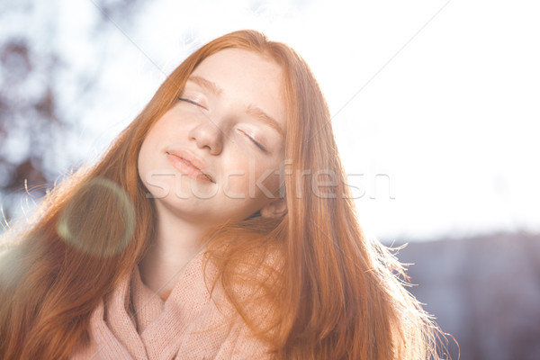 Relaxed redhead woman standing outdoors  Stock photo © deandrobot