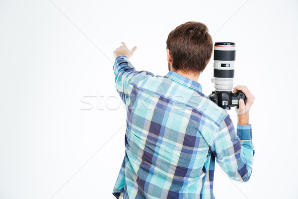 Photographer pointing on something Stock photo © deandrobot