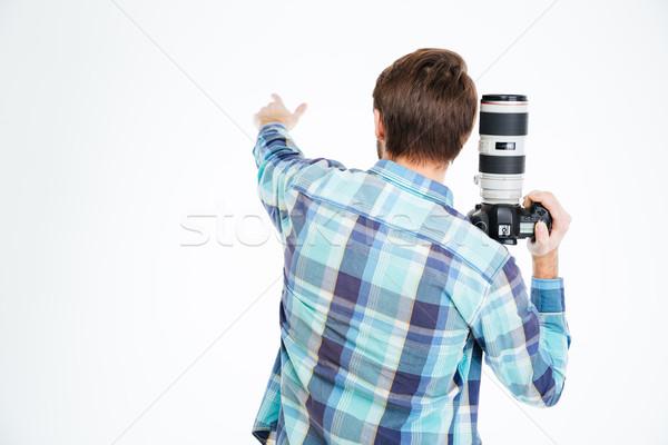 Fotoğrafçı işaret bir şey arkadan görünüm portre erkek Stok fotoğraf © deandrobot