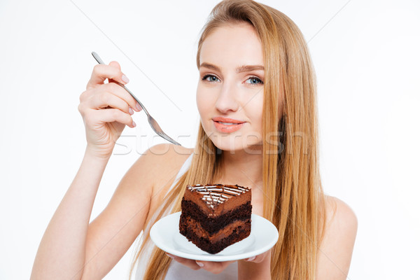 Smiling beautiful young woman eating chocolate cake Stock photo © deandrobot