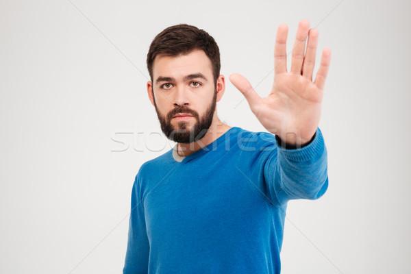 Férfi mutat stoptábla pálma izolált fehér Stock fotó © deandrobot