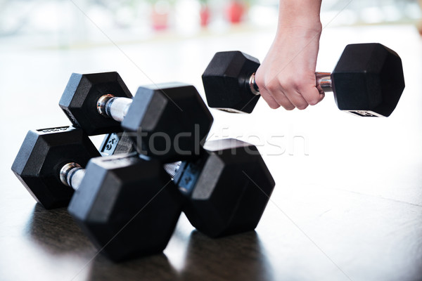 Stock photo: Two pairs of metal dumbbells on the floor
