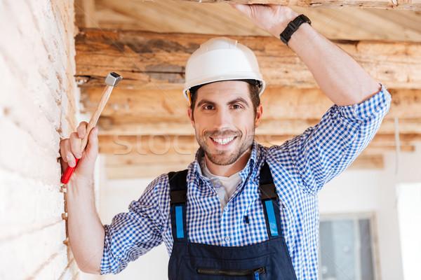 Retrato bonito handyman alegre sorridente Foto stock © deandrobot