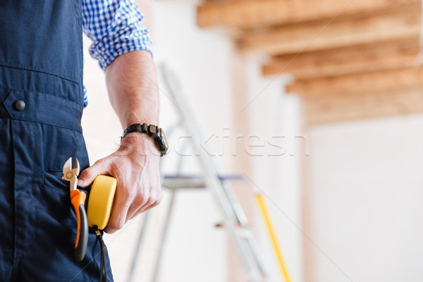Imagem mão fita métrica handyman amarelo Foto stock © deandrobot