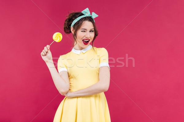 очаровательный pinup девушки желтый леденец Сток-фото © deandrobot