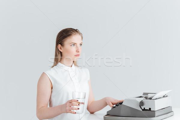 Woman worrking on retro print machine Stock photo © deandrobot