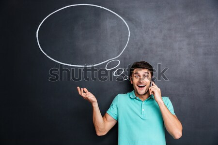 Pensive attractive young man with thinking bubble Stock photo © deandrobot