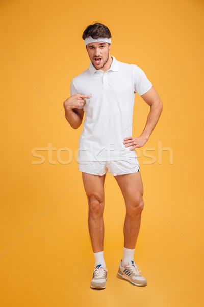 Funny confident young sportsman standing and pointing on himself Stock photo © deandrobot