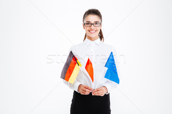 Cheerful businesswoman holding flags of Poland, Germany and European Union Stock photo © deandrobot