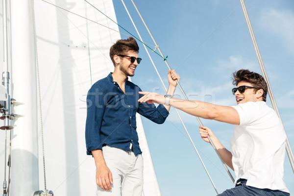 Kettő fiatal jóképű férfiak beszél áll Stock fotó © deandrobot