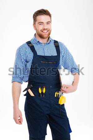 Cropped image of a worker holding helmet Stock photo © deandrobot