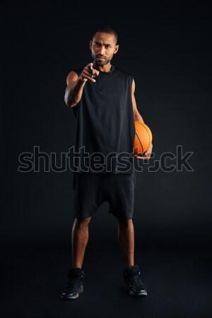Sportok férfi kosár labda tart kéz Stock fotó © deandrobot