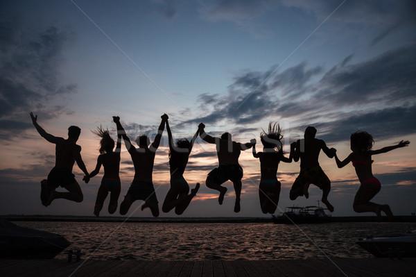 背面図 友達 ジャンプ 水 日没 夏休み ストックフォト © deandrobot