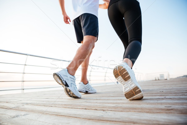 Obraz człowiek kobieta jogging odkryty molo Zdjęcia stock © deandrobot