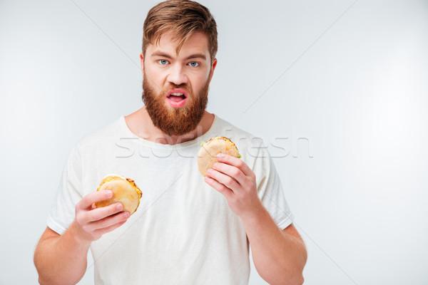 Głodny młodych brodaty człowiek dwa Zdjęcia stock © deandrobot