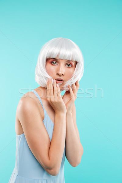 Portret aantrekkelijk jonge vrouw blond pruik Blauw Stockfoto © deandrobot