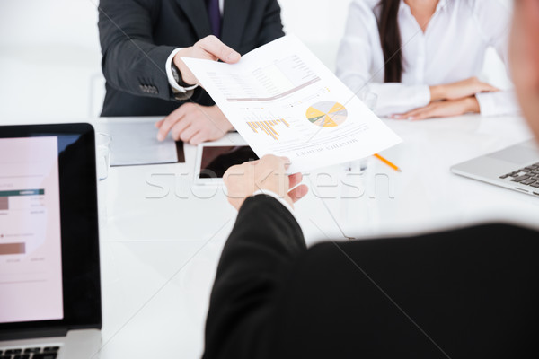 Cropped image of business partners with documents Stock photo © deandrobot