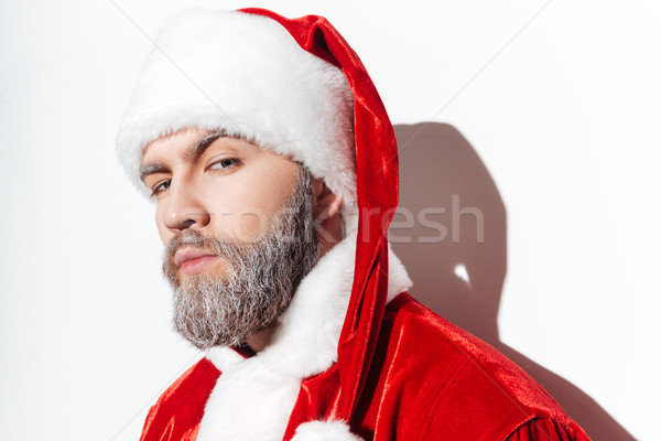 Portrait of serious santa claus in costume and hat Stock photo © deandrobot