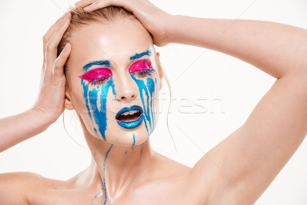 Portrait of beautiful girl with blue tears Stock photo © deandrobot
