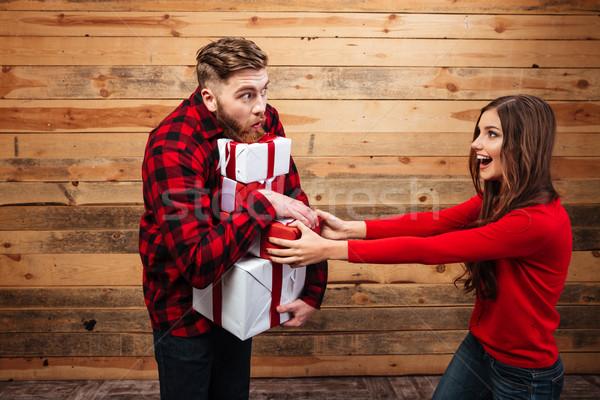 Heureux joyeux couple célébrer nouvelle année tas Photo stock © deandrobot