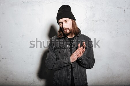 Serious hipster in snap back Stock photo © deandrobot