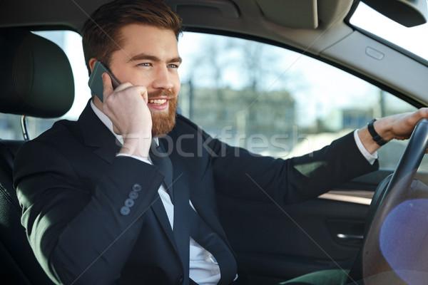 Vue de côté homme d'affaires séance roue costume parler Photo stock © deandrobot