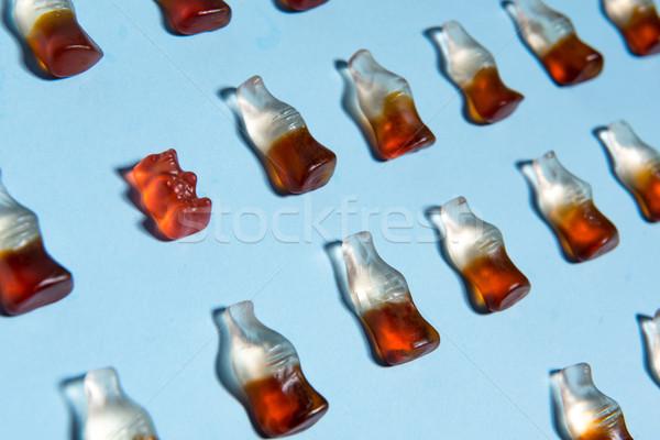 Mastigar doce garrafa forma azul quadro Foto stock © deandrobot