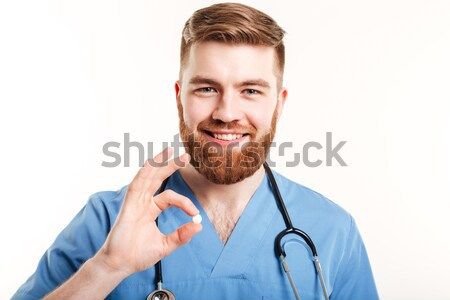 Portrait of a smiling young male medical doctor or nurse Stock photo © deandrobot