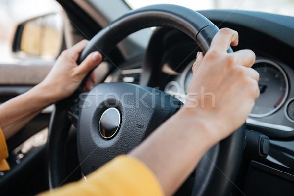 Femenino manos volante conducción coche primer plano Foto stock © deandrobot