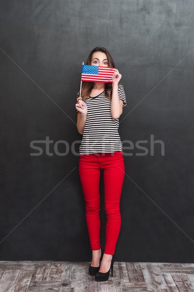 Teljes alakos portré nő rejtőzködik USA zászló Stock fotó © deandrobot