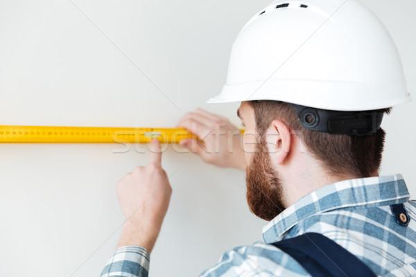 вид сзади человека строителя правителя мера длина Сток-фото © deandrobot