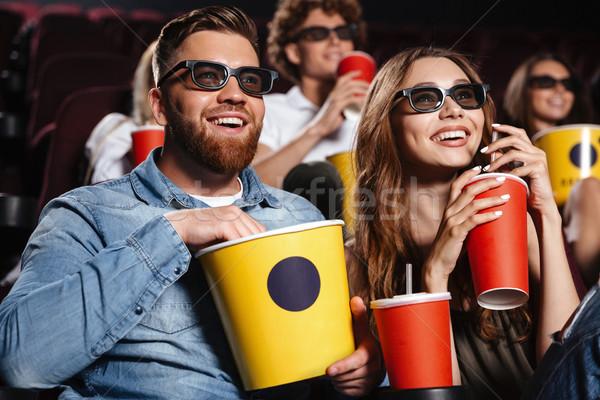 Happy friends sitting in cinema watch film Stock photo © deandrobot
