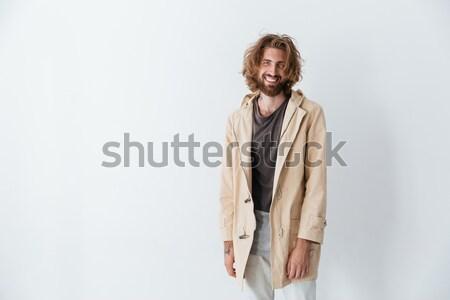 Giovani felice barbuto uomo piedi Foto d'archivio © deandrobot