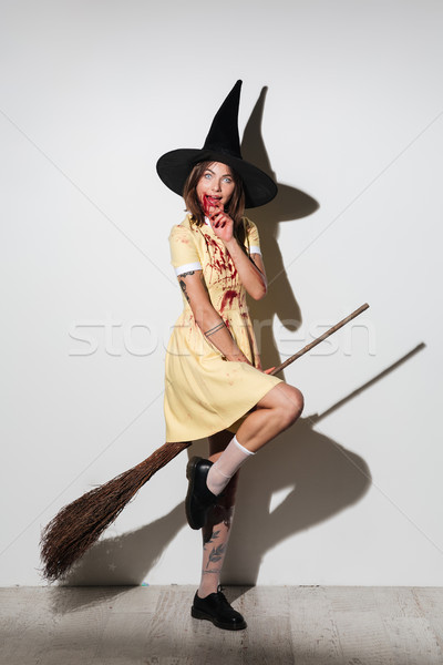 Full length image of smiling crazy woman in halloween costume Stock photo © deandrobot
