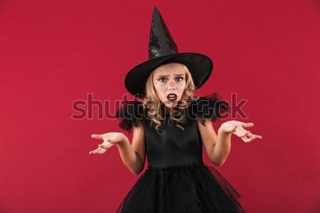 Happy woman in halloween costume making selfie on smartphone Stock photo © deandrobot